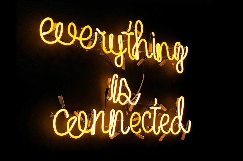 Neon sign of everything is connected illustrates the Principle of the Everything