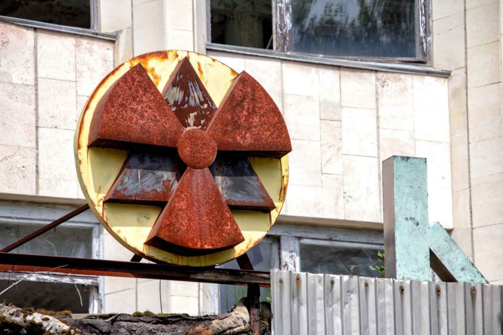 Red and yellow radioactive signage at the building starkly indicate there are lessons from Chernobyl to learn here.